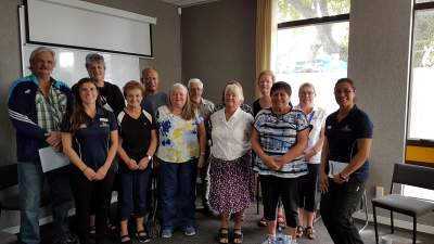 Brenda (centre, white top) with the GRx Rotorua Coffee Group.