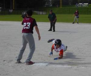 Tauranga Tide's Luke Devine sliding into base.