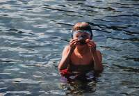 Water Safety - child swimming with snorkel mask